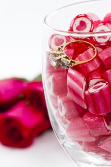 Free Diamond Ring And Candy In Wine Glass Stock Photos - 23288063