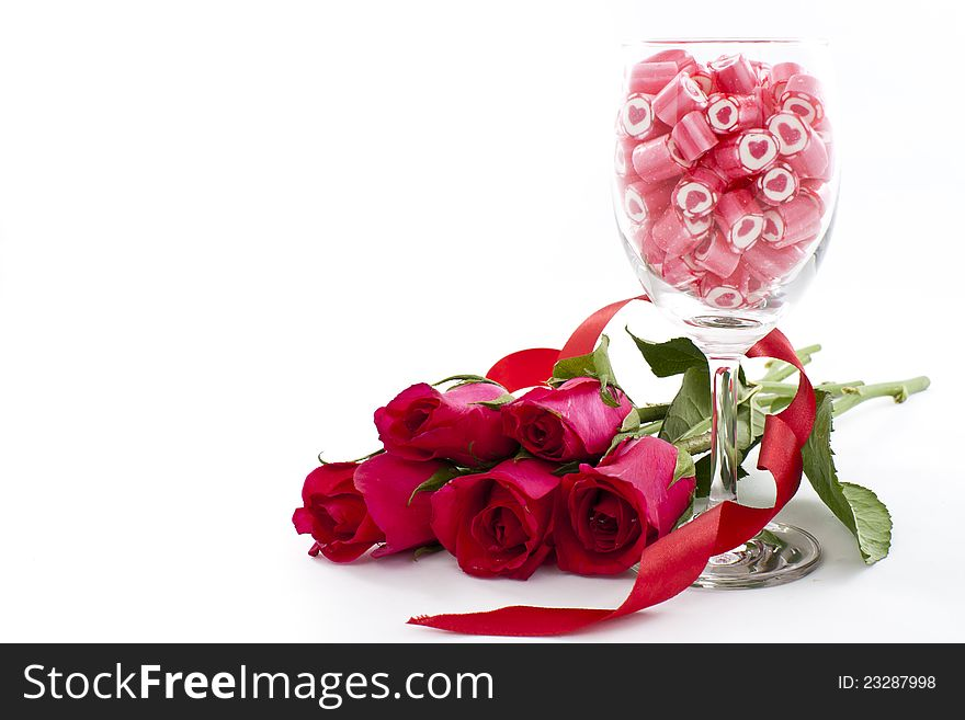 Candy in wine glass with rose