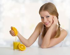 Free Girl Squeezes The Juice From The Orange Stock Photo - 23291880