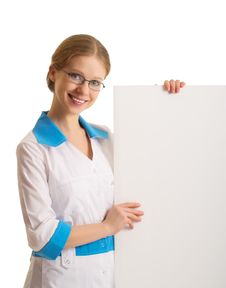 Free Female Doctor Holding A Blank Billboard Royalty Free Stock Image - 23292016