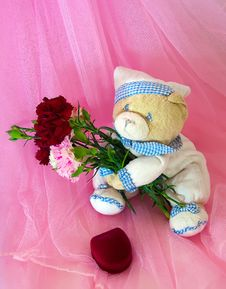 Free Sad Love Teddy Bear With Flowers And Gifts. Stock Image - 23298401