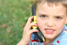 Cute Little Boy On Cell Phone Stock Photography