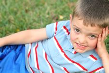 Free Little Boy In The Grass Royalty Free Stock Photos - 2330988
