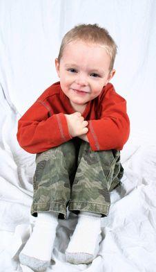 Free Cute Little Boy Sitting Stock Image - 2333571