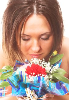 Free Woman Sniffing Flowers Royalty Free Stock Photos - 2335168