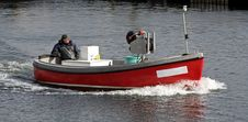 Free Fisherman In A Motor Boat Royalty Free Stock Photography - 2337877