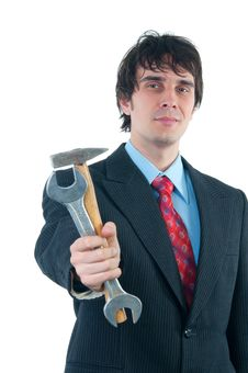 Free Smiling Businessman Handing Out Hammer And Wrench Stock Photos - 23302113