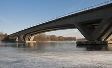 Bridge Crossing The River With Ice Stock Photos