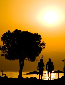 Male And Female At Sunrise Stock Photography