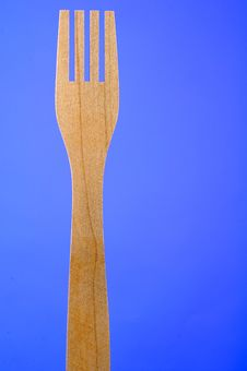 Free Wooden Fork On Blue Background With Copy Space Stock Photography - 23320192