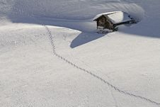Snowbound Hut With Snow Shoe Tracks Royalty Free Stock Photo