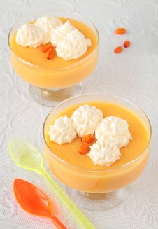 Two Glass Goblets With Mousse Of Sea-buckthorn Royalty Free Stock Photos