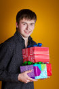 Free Present Gifts Holding Man Looking Camera Royalty Free Stock Photos - 23331228