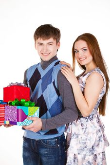 Free Young Couple With Gifts Royalty Free Stock Photos - 23331048