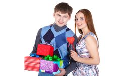Free Young Couple With Gifts Royalty Free Stock Photos - 23331068
