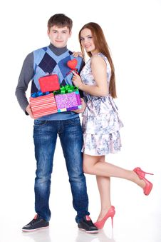Free Young Couple With Gifts Royalty Free Stock Photos - 23331088
