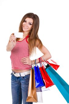 Free Young Woman Holding Shopping Bags And Card Royalty Free Stock Images - 23331259