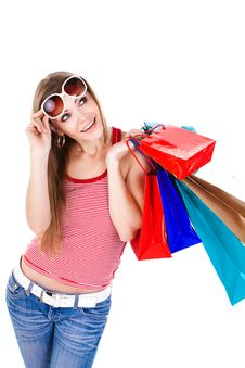 Free Young Woman Holding Shopping Bags Royalty Free Stock Image - 23331286