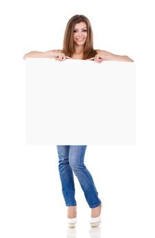 Free Happy Young Woman Holding A Blank Billboard Royalty Free Stock Photo - 23331385