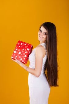 Free Woman In White Dress With A Gift Royalty Free Stock Image - 23336716