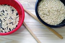 Rice In Red And Black Bowls Stock Photo