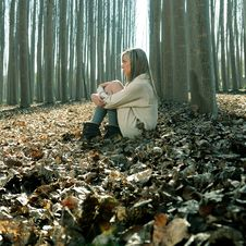 Free Beautiful Blonde Girl Thinking In The Woods Stock Photos - 23350023