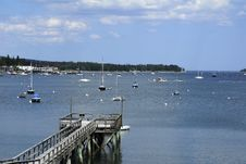 Free Wooden Dock In A Maine Harbor Stock Photo - 23350180