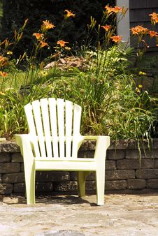 Free Garden Chair And Tiger Lilies Stock Images - 23350324