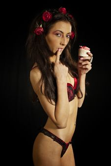 Free Girl In Red Lingerie Eating Cake Royalty Free Stock Photography - 23367837