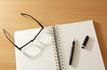 Free Notebook With Pen And Glasses Stock Photography - 23377872