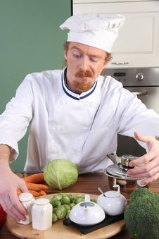 Free Young Chef Preparing Lunch In Kitchen Royalty Free Stock Image - 23376816