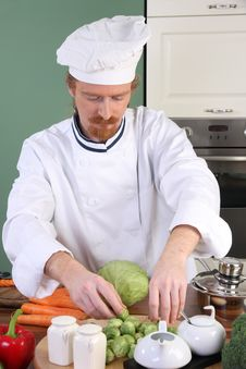 Free Young Chef Preparing Lunch In Kitchen Royalty Free Stock Image - 23376836