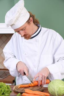 Free Young Chef Preparing Lunch In Kitchen Royalty Free Stock Photos - 23376928