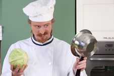 Free Young Chef Preparing Lunch In Kitchen Stock Image - 23377071
