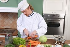 Free Young Chef Preparing Lunch In Kitchen Royalty Free Stock Image - 23377096