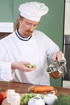 Free Young Chef With Brussels Sprouts Royalty Free Stock Image - 23377196