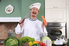 Free Funny Young Chef Preparing Lunch In Kitchen Stock Photos - 23377323