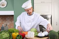 Free Young Chef Preparing Lunch In Kitchen Royalty Free Stock Images - 23377329