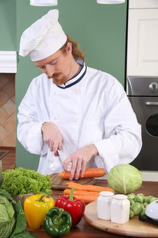 Young Chef Preparing Lunch In Kitchen Stock Photography