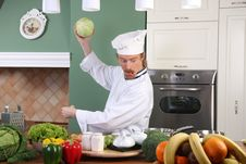 Free Young Chef Preparing Lunch In Kitchen Stock Photos - 23377753