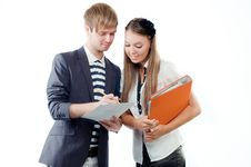 Young Man Explaining Something To Young Woman Royalty Free Stock Image