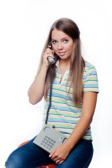 Young Woman Holding A Phone Isolated On White Stock Image