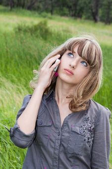 Schoolgirl Speaks By Mobile Phone Stock Photo