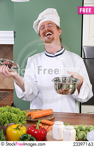 Free Young Chef Preparing Lunch In Kitchen Stock Photos - 23397163