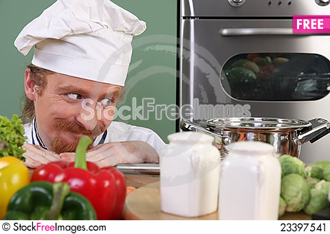 Free Young Chef Preparing Lunch In Kitchen Stock Image - 23397541