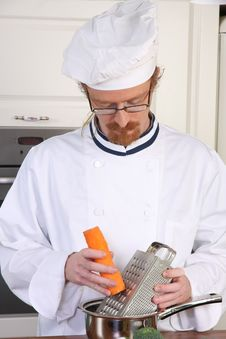 Free Young Chef Preparing Lunch In Kitchen Stock Photography - 23397182