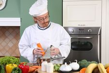 Free Young Chef Preparing Lunch In Kitchen Stock Photos - 23397273