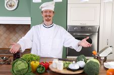 Free Young Chef Preparing Lunch In Kitchen Stock Image - 23397511