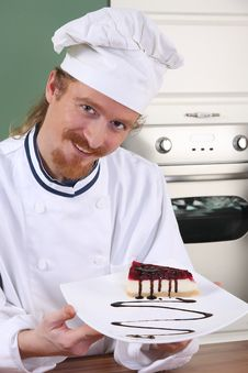 Free Young Chef With Piece Of Cake Stock Image - 23397851