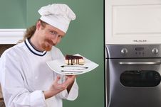 Free Young Chef With Piece Of Cake Stock Photos - 23397883